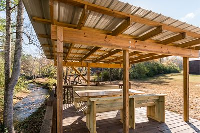 Sit under gazebo near firepit while eating your meal and listen to rushing creek