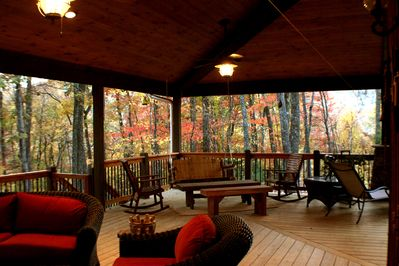 More of theHUGE covered porch, complete with swing, rocking chairs, dining table