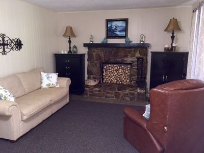 Come spring, the fireplace is still a cozy retreat. Closed off for season.