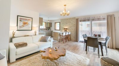 Photo for Spacious and warm prestige apartment near the center and the ski lifts