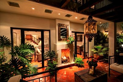 The beautiful terrace, with fireplace, off the main level.