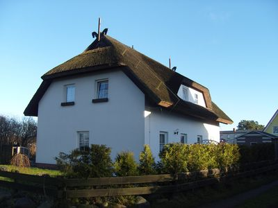 Photo for Individual and family friendly thatched house with private garden