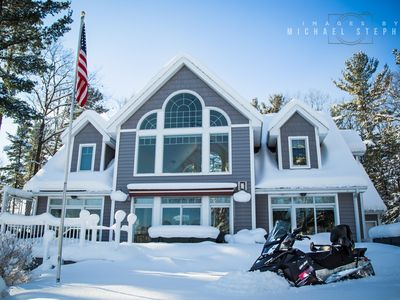 Photo for Exceptional waterfront retreat with sandy beach on all sports Spider Lake