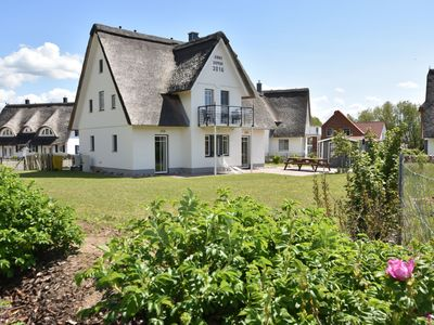 Photo for Large thatched holiday home on three floors, close to the beach