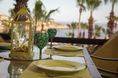 Enjoy a relaxing meal on the patio along with a sweeping ocean view