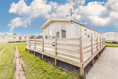 Caravan for hire with decking at Broadland Sands