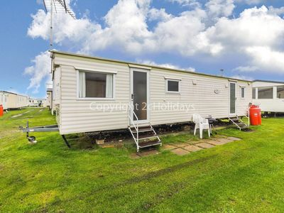 Photo for A great caravan for hire by the beautiful beach of Heacham in Norfolk ref 21047.