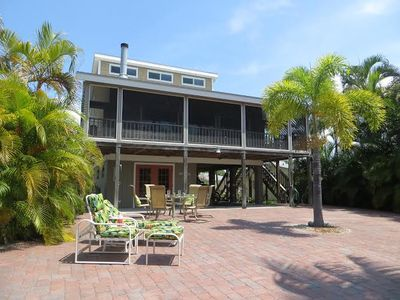 Photo for Close To Beach - Mid-Island Canal Home With Boat Dock And Lift