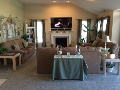 Living area with 3 couches in Great Room with Dining Table behind you