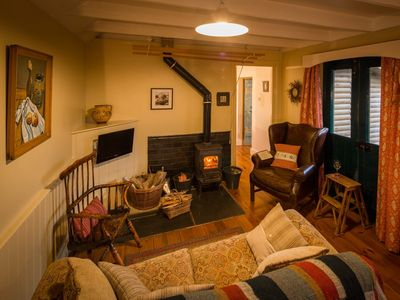 Cosy lounge area with warming woodburner