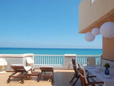 Photo for Wonderful penthouse with terrace of 140m in front of the beach.