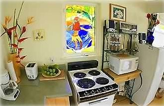 Full kitchen. Beautiful hula girl stained glass and many other special touches