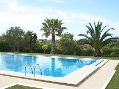 Photo for 3 km from Sesimbra, comfortable apartment, 12 nearby beaches, swimming pool and garden