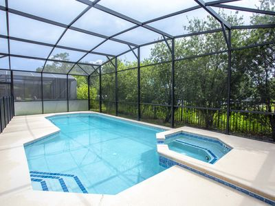 Photo for 6-bedroom house w/ private pool 10 min from Disney