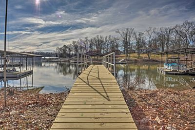 Disconnect with a stay at this Kentucky Lake home, with a dock & boat slip!