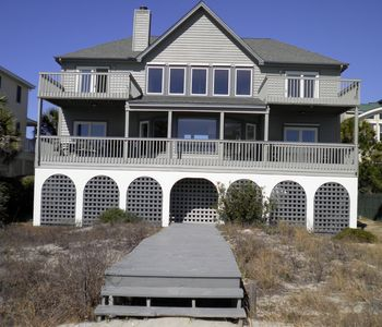 Ocean side showing covered deck below and open decks above