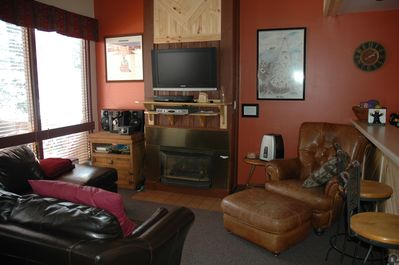 Living Room with Gas Fireplace, Flat Screen T.V., WI-FI and Stereo.