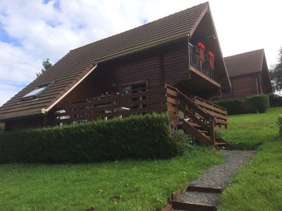 Photo for Traditional Log Cabin on quiet Residential Site with communal Heated Pool