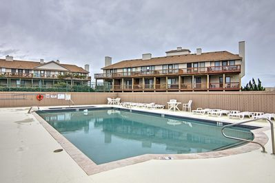 Relax at the community pool and hot tub at the Sea Dunes community!