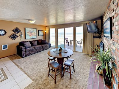 Living Room - The sunlit living space provides stunning views of the ocean.