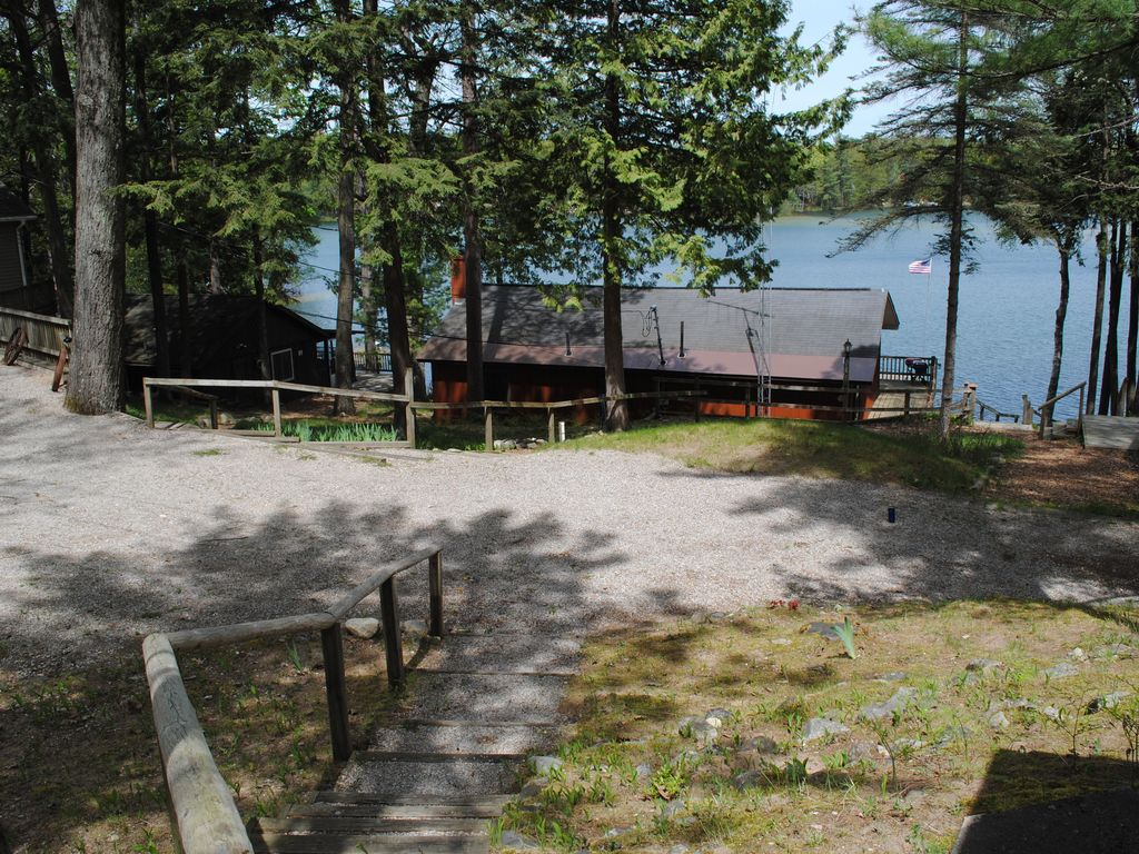 area cabin home property yards bellaire deal from traverse downtown in waterfront conservation s luxury city min ha image bed the cabins style beach