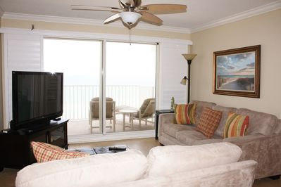 Beachfront living room with balcony and plantation shutters