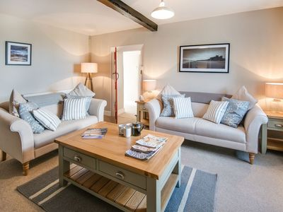Photo for ST AIDAN'S LODGE - quaint coastal cottage, Sleeps 4, wifi, stunning beaches
