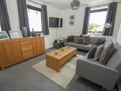 Photo for Centrally located two bed to sleep five people that comes with a shared roof terrace with sea views