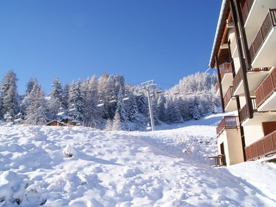 Photo for Beautifully renovated ski in/out apartment next to chair lift & restaurant
