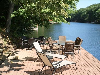 Relax with a drink in hand while your family kayaks down the lake