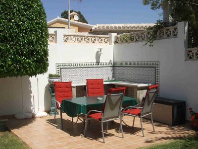 Photo for Bungalow on a wonderful palmed property - 2 min from the beach