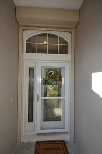 Inviting front entrance with double glass door