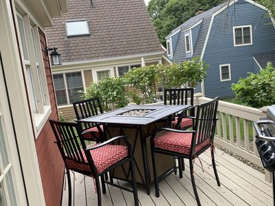 Back deck with table/ Fire pit