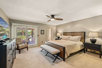 Master Bedroom with En Suite Bath and large HDTV Opens to Pool and Patio