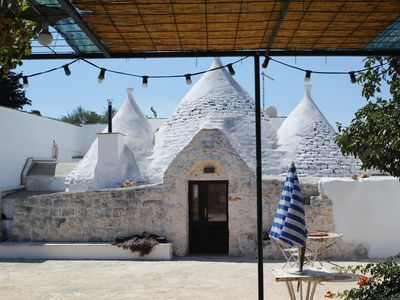 Photo for Trullo Apulia holiday home with above ground pool