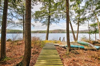 Walk along a private boardwalk leading to the lake shore at this Francestown vacation rental home!