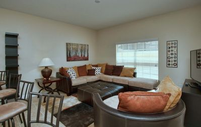 Photo for SOUTH FACING POOL, SPACIOUS, CLOSE TO DISNEY, GATED RESORT COMMUNITY, FLAT SCREEN TV IN EVERY ROOM!