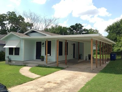 Enjoy beautiful lawns in front and rear, and a shaded carport.