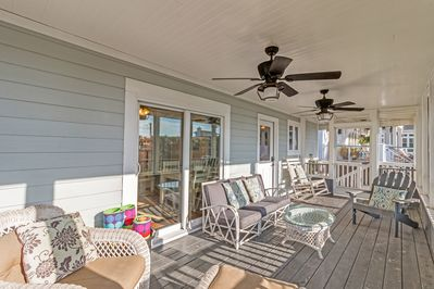 Screened Porch - A comfortable spot to relax, the screened porch has overhead fans to keep you cool.
