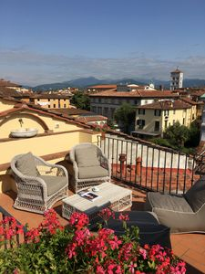 Photo for Luxury Italian penthouse in Lucca historic centre, two terraces, 360°views, lift