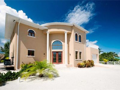 Photo for Casuarina Cove: Beachfront Villa Walking Distance from Rum Point