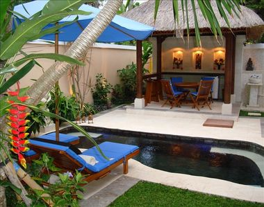 Private pool gazabo and sunbeds