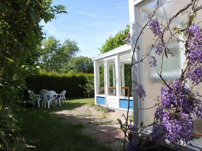Photo for Comfortable chalet with a beautiful garden in a small park near the beach
