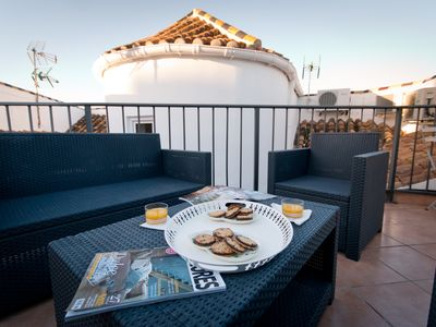 Photo for Penthouse duplex with terrace solarium in Larios Street, close port and beach