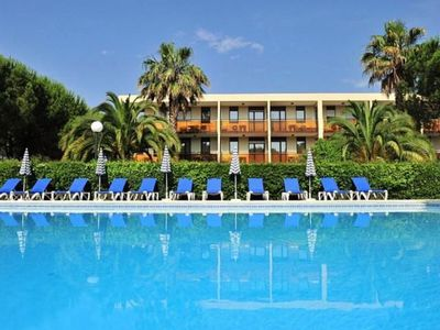 Photo for Studio cabin with private garden at 800m from the beach, swimming pool and parking