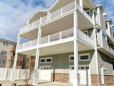 Great Location! Beautiful new beach block townhome just steps to Sea Isle City's sandy beaches. Onsite parking for four cars
