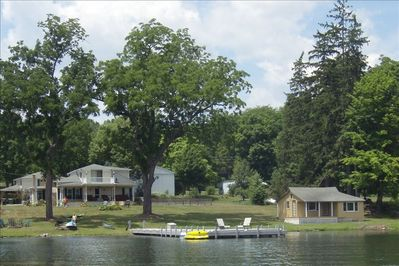 "Beautiful Keuka Manor from the lake with the ""honeymoon cottage"" (priced separat"