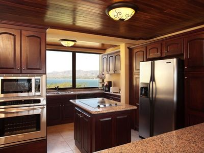 Fully furnished kitchen with granite countertops and views of the marina area