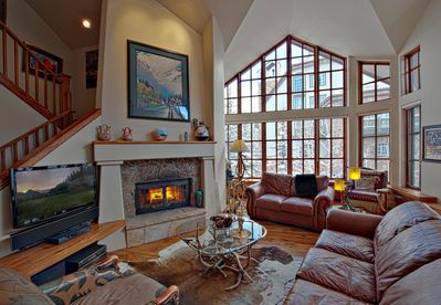 Take a seat in front of the cozy fireplace after a day on the mountain.