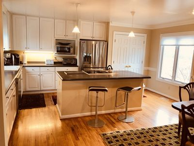 Fully equipped Kitchen with stainless appliances, large pantry, bar seating